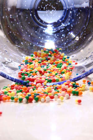 hundreds: Hundreds & thousands spilt from glass