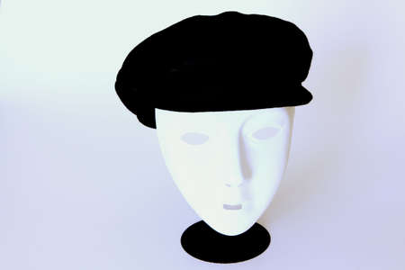 pretense: Hat on Face Mask Stock Photo
