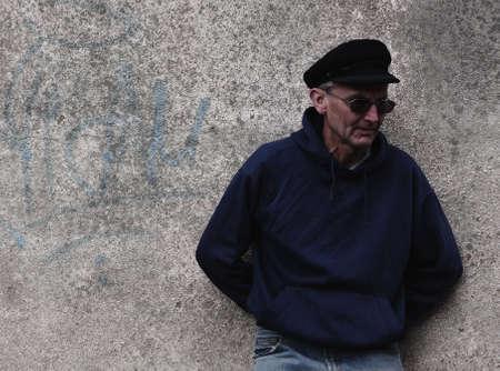 ornery: Man by graffiti on wall Stock Photo
