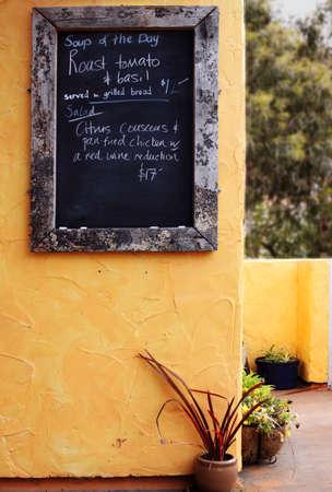 Menu specials on chalkboard Standard-Bild