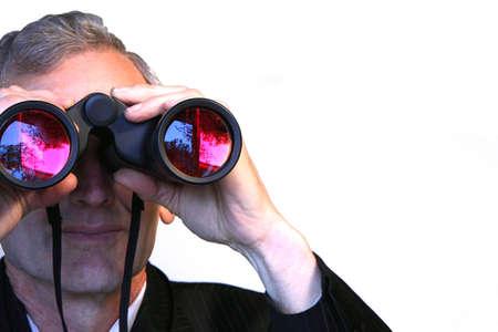 Business Executive looking into the distance through binoculars Standard-Bild