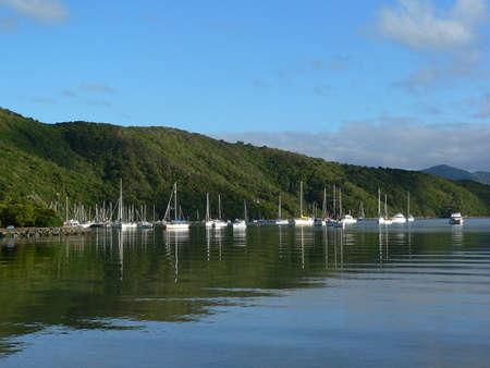 Boats moored on water in Marlborough Sounds New Zealand Standard-Bild
