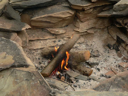 stone  fireplace: Fire in stone fireplace Stock Photo