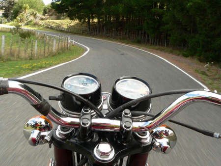 dangerous road: View from moving motorcycle  Stock Photo