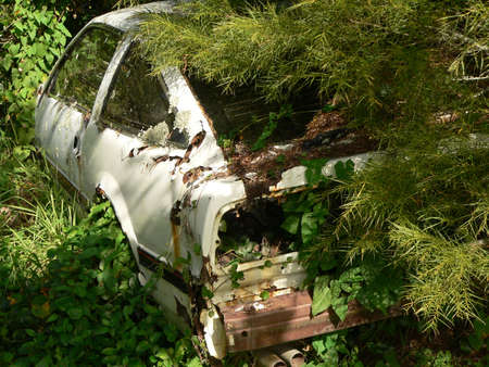 Abandoned shell of an old car photo