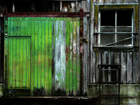 antique factory: Door and window of old barn with peeling paint Stock Photo