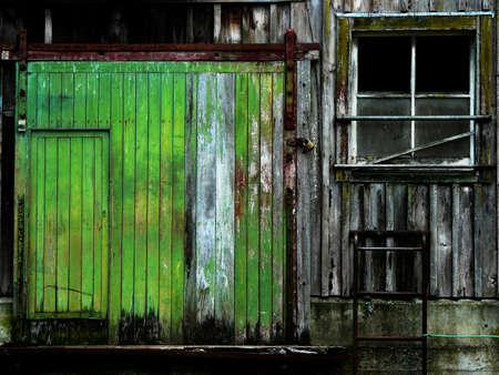 Door and window of old barn with peeling paint Standard-Bild