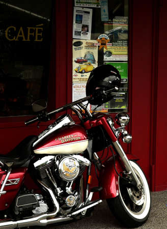 harley davidson motorcycle: Motorcycle parked outside cafe Stock Photo