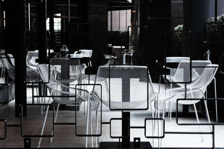 Black and white chairs and tables in a cafe