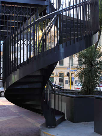 Spiral staircase in street photo