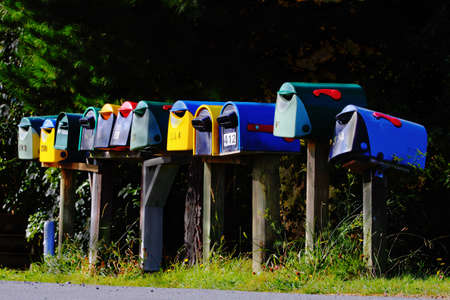 Brightly coloured etterboxes in a row photo