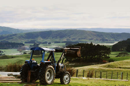 Rural scene with tractor in foreground