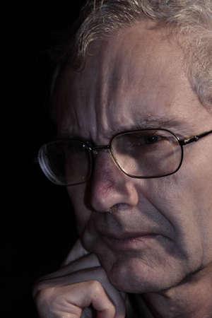 Older person showing frowning emotion Standard-Bild