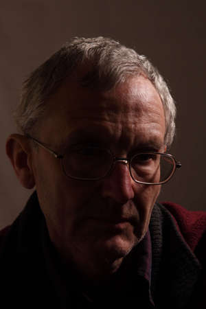 shadowy: Older man partly shaded, signifying depression