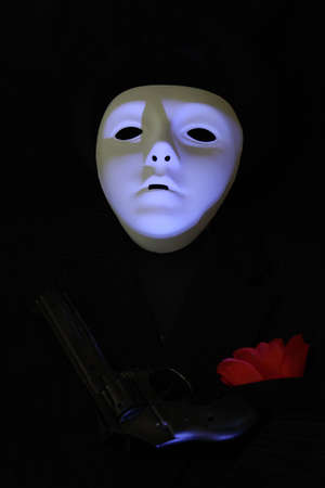 Mask of a ghoul with gun