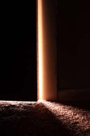 Light showing through slightly open door photo