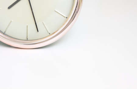 Clock showing the time, space for text, white background Standard-Bild