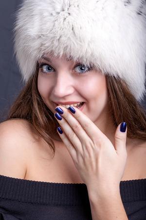winter hat: Portrait of a beautiful girl in winter hat Stock Photo