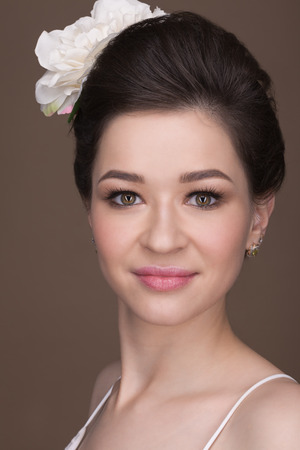 black hair girl: Portrait of a brunette with a flower on her head