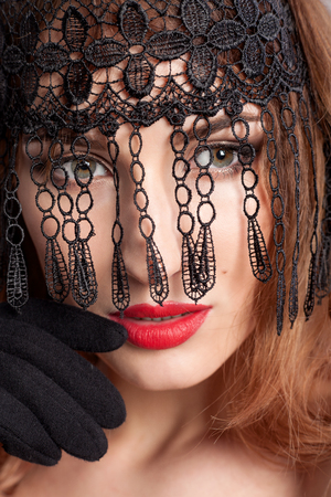 black mask: Portrait of a girl in a black mask with red lipstick