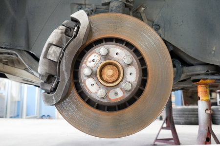 brake caliper: Front disk and caliper brake. Stock Photo