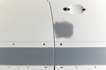 primer: A car is prepared with grey primer. Stock Photo