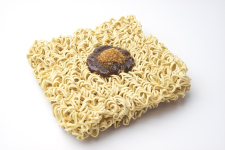glutamate: Oblique instance noodle has flavouring on top.
