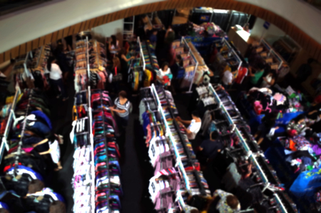 end of year: Peoples are selecting clothes in End Of Year Sales.