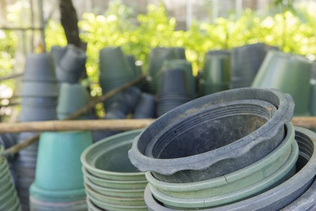 stocked: Plastic green pot is stocked in storehouse