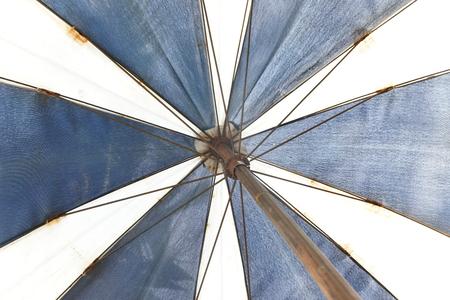 white canvas: Blue and white canvas umbrella.