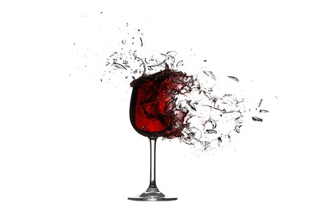 green glass bottle: Explosion of a glass with red wine    Stock Photo
