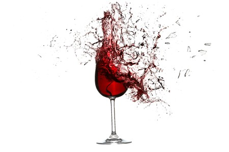 Explosion of a glass with red wine isolated on a white background. High Quality XXL!