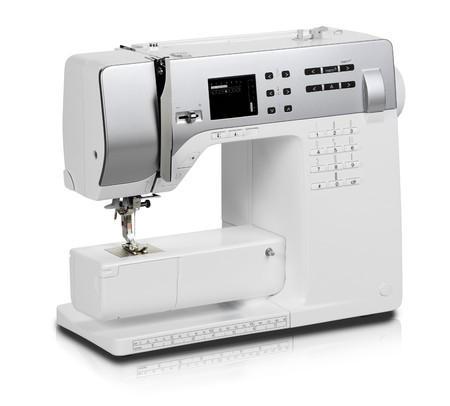 Modern electric sewing machine isolated on white background Stock Photo - 7592796