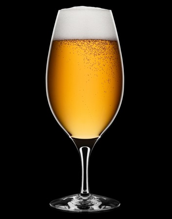 beer drinking: Fresh foamy beer in a glass on a black background with clipping path. Stock Photo