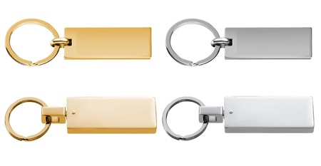luggage pieces: Gold &amp, Silver Labels or Tags or Charm isolated on white background Stock Photo