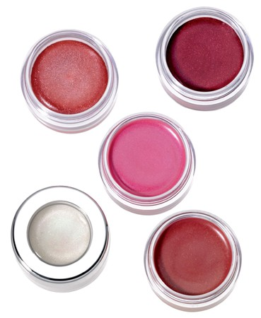 Multy-colored lip gloss in round silver plastic containers on white background Lip Gloss Dot