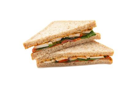 Gezonde ham sandwich met kaas, tomaten en sla