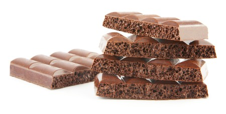 honeycombed: Stack of brown porous chocolate isolated on white background