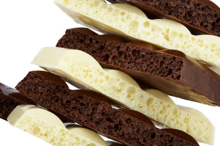 honeycombed: Stack of brown and white porous chocolate isolated on the white background