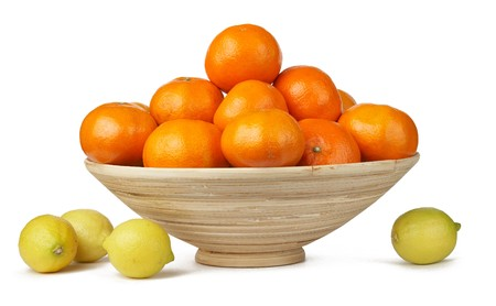 Tropical fruits in the woven basket isolated. �andarins, lemons. For design of interiors  photo
