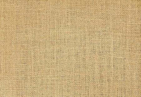 Close-up of natural burlap hessian sacking. Background texture using burlap material. Фото со стока