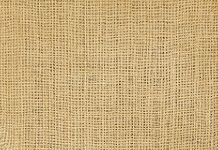 Close-up of natural burlap hessian sacking. Background texture using burlap material.