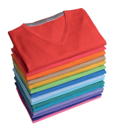 pile of colorful t-shirts freshly folded from the laundry