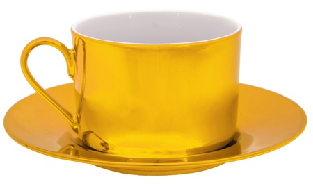 Golden cup isolated on white photo