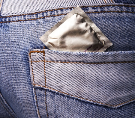 Condom in the pocket of a blue jeans Stock Photo