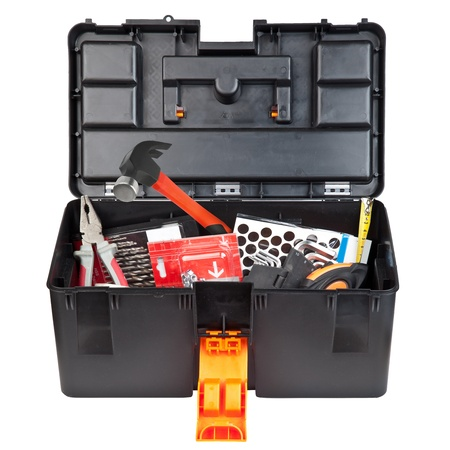 Tools and instruments is in a black plastic box isolated on white background photo