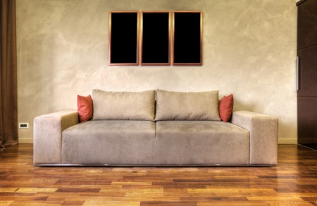 modern sofa in a white living room-rendering- the art pictures on wall are my composition Stock Photo