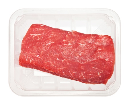 huge red meat chunk in box isolated over white background photo