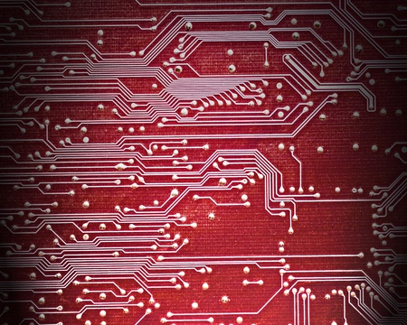 Close up of computer circuit board in red photo