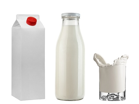 Bottle & pasteurized box with milk   Freeze milk in glass isolated on white background photo